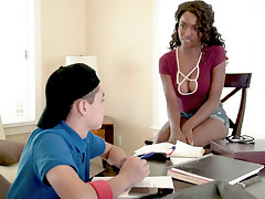 Curly-haired black MILF getting fucked by a young white boy