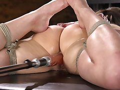 Beautiful Kenzi Ryans spreads her legs for two huge sex toys