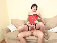Superannuated whore in a sexy corset bounces chiefly his locate